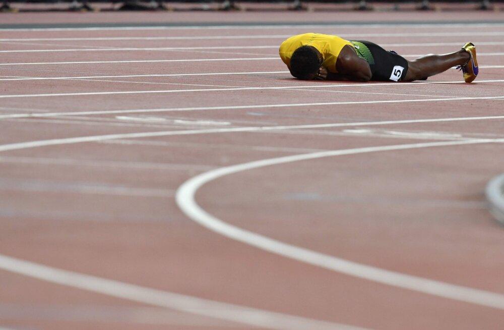 FOTOD   Usain Bolt sai karjääri viimases suures jooksus vigastada