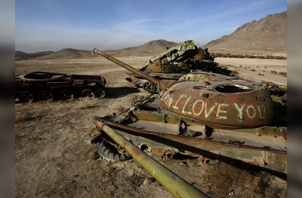 """A rusting tank carries the message """"I love you"""" in a junkyard of Soviet armoured vehicles and tanks at the Kabul Military Training Camp near the capital on January 13, 2010.  The USSR began its invasion of Afghanistan in 1979 and installed more than 10,00"""