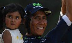 Nairo Quintana tütrega Pariisis poodiumil